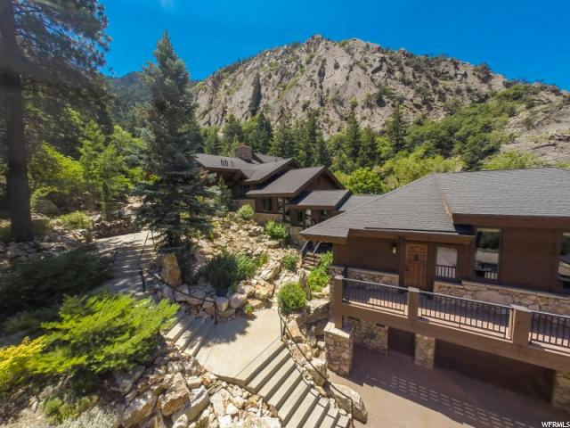 "BITCOIN ACCEPTED!! TAKE A ""PEEK"" Of the Tour.   Just minutes to your front door from either SLC International Airport (45 min. approx.) or (15 min. approx.) from the Ogden Regional Airport. You will arrive to the most extraordinary setting and home on 67 acres. Soaring mountain peaks & breathtaking views, cliffs, & old growth pines. 15/20 min. to one of Northern America's top rated ski resorts, Snowbasin/A Sun Valley Resort and Powder Mountain. Many hiking trails from your door step, including Indian Trail, Malans Peak, and all the other activities you would want, or Just find yourself browsing or eating in the many choices you'll have, within 15 min. of the Ogden Valley or Ogden proper. The home was constructed following the Natural contours of the canyon.  Each level is stunning with the highest quality workmanship and materials.  Spectacular timber frame with solid beams. Chefs kitchen, Master suite that overlooks a waterfall and trout pond (fed by a year round spring.) The guest wing provides luxurious comforts in a setting that feels like paradise."