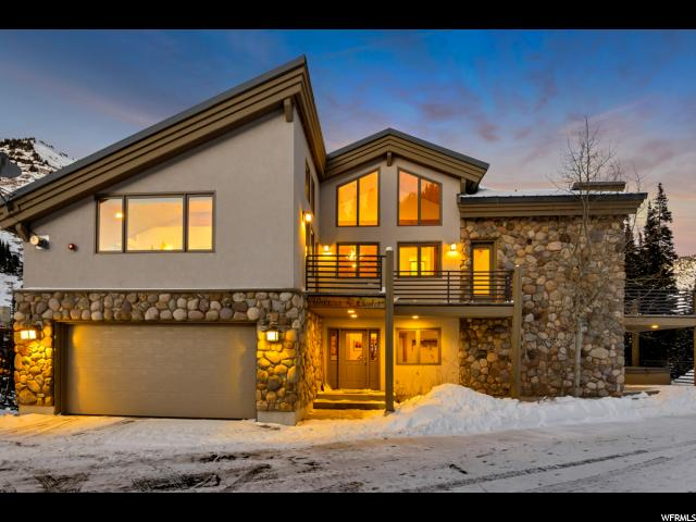 Beautiful ski in/ ski out custom home at the end of Powder Ridge.  Open floor plan with vaulted ceilings and expansive windows make for lots of natural light and breathtaking views.