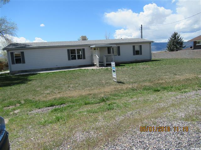 If you have been looking for a great home in Moroni than this is it. Nearly 1800 sq.ft. rambler on a large lot.  Over-sized detached 2 car garage.  .33 acres, patio.  This is an excellent value.  Home currently has 3 bedrooms, 2 baths, Living and family room and the a den that could be another bedroom.  Master suite has both a tub and shower.  This is one you must see. Sq.ft. as per county assessor.  Buyer and Buyers agent to verify ALL information. Owner and nonprofit buyers only for the first 20 days.  Investor offers will be reviewed starting day 21.  Buyers will be required to sign an occupancy cert.  Sellers will review offers after the property has been on the market 7 days