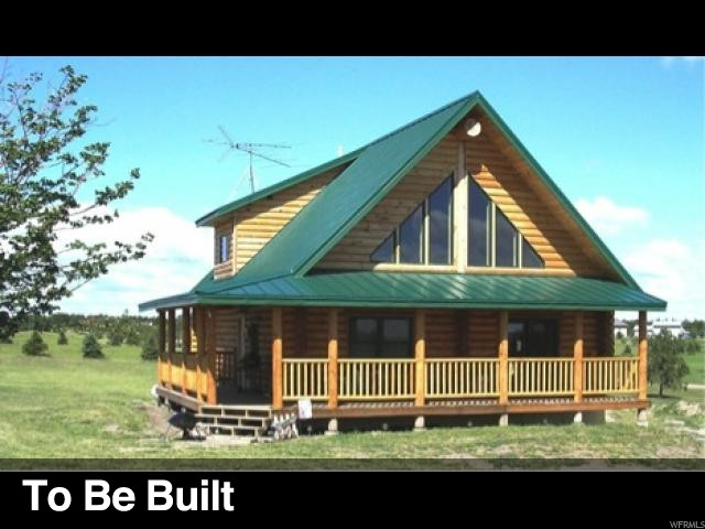 Energy efficient log home to be built on the golf course and a short walk from the swimming pool, tennis courts, and club house. Year round access.  Seasonal stream runs through the property. Square footage is provided as a courtesy estimate only.