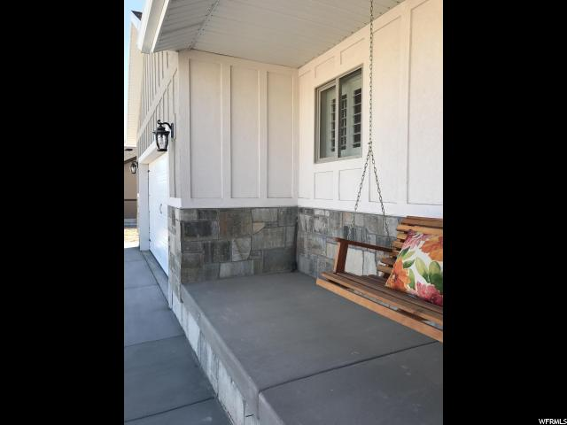 Move in Ready Charming Rambler nestled in the foothills of quiet Moroni. 100% finished 4bedroom 3bath 2car. plenty of room to park on side of house or out back. Exterior is stucco & platinum stone an extra pad of drive way cement, walkway attaches to the back patio. Enjoy the inviting front porch with a swing and take in the views of Sanpete Valley. Home offers granite shutter window coverings main level. LED fixtures inside home. window well covers. Laundry main level. Upgraded  tall toilets. Extra linen closet in master bath. Space for desk/computer. Lots of storage under stairs & cold storage. Appliances are smudge proof slate GE and has the slide in electric range not the freestanding. Area is stubbed for gas if preferred. Home comes with a 1/2 share Moroni irrigation. Garage is finished with trim and blinds to insure completeness.. Yard is complete with auto sprinkler system and manicured lawn with curb detail. Driveway has been packed with sand and gravel. Verified buyer/loan approved will be able to view the home. Square footage is approximate. Just going off plans. Sq footage does not include garage. Mt Pleasant community pool about 8 miles from house.
