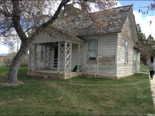 "Charming farmhouse on lovely corner lot.  Seasonal stream, apple tree, mature trees.   Home is original (with some 1950s updates).  High ceilings, great functional appliances.  Needs lots of work and love, but oozes charm. Great investment opportunity.  Owner is licensed agent in state of Utah.  One share of Horseshoe Irrigation water is included in sale.  Property sold ""AS IS"".  Owner Agent"