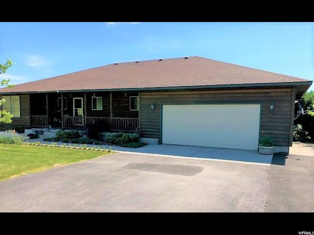Beautiful log sided 3274 sq ft home on 9.54 acres with full walkout basement, quartz kitchen counter tops, vaulted ceilings, Located on the Malad Summit. Lots and lots of trees, amazing views, year round access, RV parking, horse property, GREAT PROPERTY  BIG Price Reduction.  OWNER MOTIVATED.