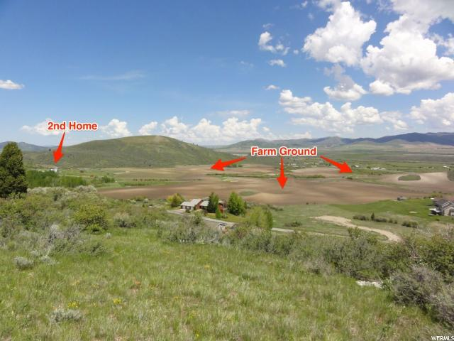 An amazing setting comes with a recently updated 4370 sq.ft. home.  Just 4.2 miles south of Soda Springs, Idaho.  320 tillable acres with 170 acres of irrigated ground. Outbuildings (two with cement floors) with a spectacular view of the mountains and valleys!  Hunt deer, elk, upland birds right from your own property.  Several springs and a creek are included.  This property has it all with farmland, pasture, and some wooded area.  There is additional land and an additional home for sale as well.  Seller financing available upon approval. See MLS#1470133 for additional property available.