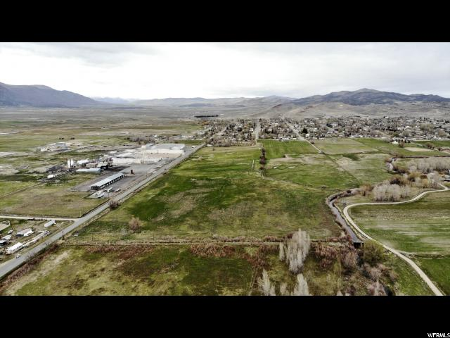 Prime farmland or opportunity right on the border of Moroni.  These six parcels are to be sold together. Parcels S19034 (5.85 acres), S19036 (5.62 acres) both fall within city limits, S25476 (9.87 acres), S25480 (9.5 acres), S25482 (9.28 acres), S25481 (10.21 acres) are in the county (see image).  An ideal setup for growing or grazing. Two parcels border the San Pitch River giving water to livestock.  Includes 28.75 shares of irrigation rights through Moroni Irrigation Company on southwest ditch #2 and a well with 75 stocking units.   Buyer to verify all info.