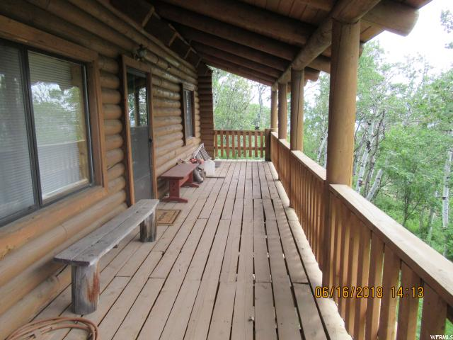 Wow family fun in the mountains!! Now you can own a piece of the beautiful Utah mountains and only 1 hour drive from Provo . Enjoy bringing your family to a fun get away with amenities like a community  pool, Tennis, golf , and play ground. But just enjoy going for rides on the roads on four wheelers or hiking and biking.   This log cabin has features like a loft to sleep more people, skylight, balcony deck, many mature aspen trees, and the seller is leaving most of the furniture. Come take a look.