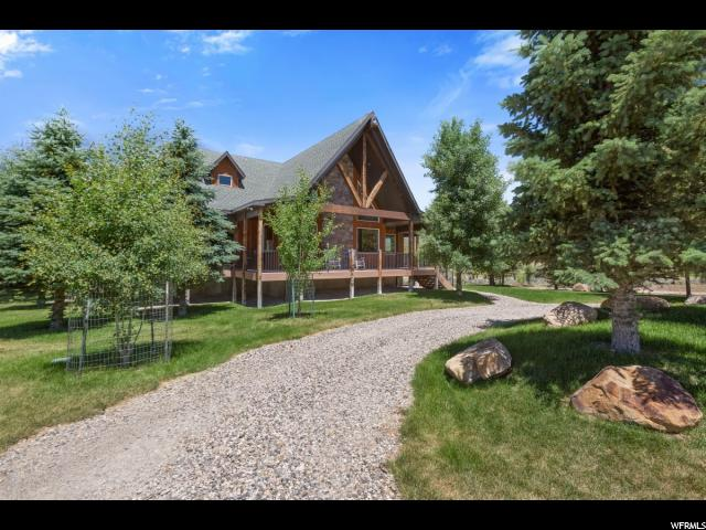 Incredible home/cabin in Skyline Mountain Resort, a gated community. Includes a huge 360-wrap-around deck, with beautiful views of the mountains and valley. Located on the golf course between the 3rd and 9th tees. Two adjacent lots are included GC16 & GC17, for a total of 1.134 acres; and must be purchased together. Includes Home Automation features, all-room tele/data wiring, and wireless network.  95% furnace + heat pump. Designed to be an ideal full time residence, or the perfect getaway!  Square footage figures are provided as a courtesy estimate only and were obtained from the county.  Buyer is advised to obtain an independent measurement.