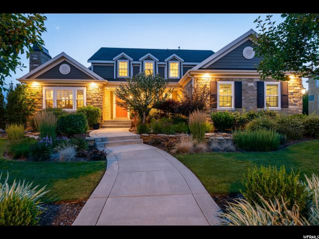 STUNNING HOME SHOWCASED IN THE 2009 PARADE OF HOMES* TRADITIONAL FLOOR PLAN WITH CONTEMPORARY FINISHES THROUGHOUT* FORMAL LIVING ROOM WITH CUSTOM FIRE PLACE FLOWS INTO THE FORMAL DINING THROUGH FRENCH DOORS*OPEN CONCEPT KITCHEN HAS VAULTED CEILINGS WITH LARGE BRIGHT WINDOWS & ANOTHER FIREPLACE*SPACIOUS MASTER SUITE ON THE MAIN*MASTER BATH HAS FLOOR TO CEILING MARBLE SEPARATE TUB , SHOWER, DBL SINKS & WALK-IN CLOSET*YOU WILL LOVE THE SPACIOUS BEDROOMS 5 TOTAL* PLUS 2ND LEVEL OFFICE*BASEMENT HAS 2ND KITCHEN, ADORABLE CRAFT ROOM. EXERCISE/DANCE ROOM, & CUSTOM THEATER ALL THEATER EQUIPMENT IS INCLUDED* SEATING NEGOTIABLE*NEW WHITE PERGOLA FOR BACK DECK* .78 ACRES WITH A PRIVATE WOODED AREA AND YES YOUR VERY OWN CREEK RUNS THROUGH IT* FULL SIZE BASKETBALL COURT*LUSH LANDSCAPING* EXTERIOR OF HOME WAS JUST REPAINTED* HARD TO FIND A HOME AND A LOT THAT ARE EQUALLY AMAZING* BEST DAVIS COUNTY SCHOOLS INCLUDE KAYSVILLE JR & DAVIS HIGH*EXCELLENT ACCESS TO SHOPPING AND FREEWAY*SO MANY DETAILS YOU MUST SEE THIS HOME IN PERSON*CALL NOW FOR YOUR PRIVATE SHOWING*  Square footage figures are provided as a courtesy estimate only and were obtained from County Records .  Buyer is advised to obtain an independent measurement.