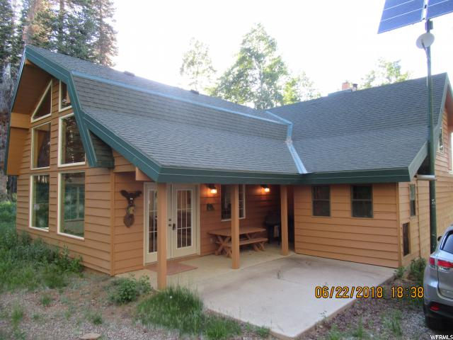 Furnished cabin on 1.25 acres at Fairview Lakes. Accommodates a crowd w/many gathering & sleeping areas: huge great room w/vaulted ceilings & wall of windows; vaulted loft; Living room w/incredible meadow view; full kitchen; 3 private bdrms; 1 bths. Covered front porch, back patio & balcony. Every room features a glorious view. Pictures do not do justice. Also includes fireplace, wood burning stove, furnace, garage w/work bench, solar power, fire-pit & back-up generator. Gated community.  Buyer and Buyers agent to verify ALL information including sq.ft.
