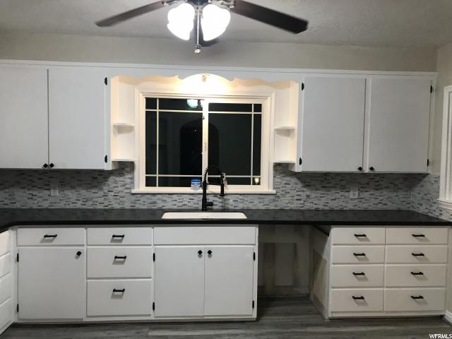 Cute Cottage house, uniquely designed archways,  brand new floors and carpets, new paint and solid surface kitchen counter tops that are smoothly designed to flow right with the sink, no gunk around the sink! New Upgraded commercial single handed pull down sprayer faucet! Must see!!