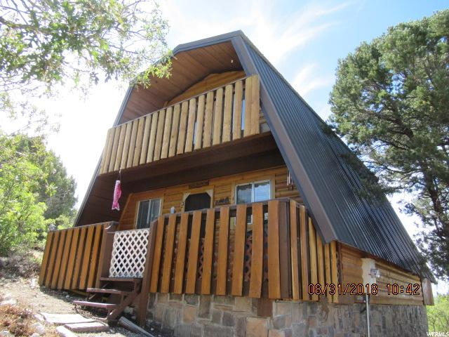 Incredible cabin or full time residence in Skyline Mountain Resort.  Fully Furnished.  Excellent Views.  Price includes 2 lots C-22, C-23.  Over 2 acres. Highest cabin in the full time area. Buyer and Buyers agent to verify square feet and ALL information.