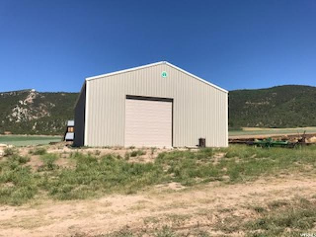 Beautiful setting at the foothills of Horseshoe Mountain, So East of Spring City on Canal Canyon Road. Brand new 'Cleary' barn 42'X64'X17'(height), with concrete floor and 12'X14' (high) door. Also, picturesque, historical barn. Perfect for horses with Horseshoe Mt. Trail for horses & hikers within 1/2 mile. 50 shares Horseshoe Mt. pressurized irrigation. Call agent for more details.