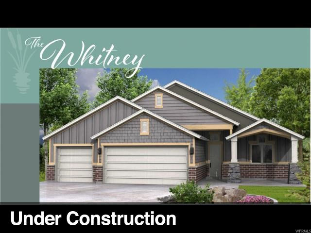 Great new 55+ community! Whitney Floor Plan 3 car garage - Lot 209 South facing lot with great view for the mountains from the covered front porch. Bright open floor plan with vaulted ceilings. Kitchen open to great room with center island walk-in pantry. Great room with large picture windows with a view of mountains. Located in a beautiful area of South Weber. Call today for all the details