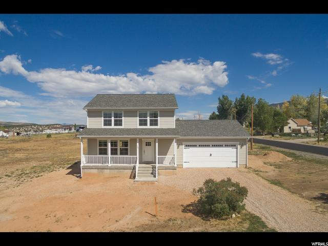 Enjoy this newly built, custom home that offers year-round access to Fairview's East Mountain, just a block away from the canyon road.  This home's design was originally part of the National Association of Home Builder's 2010 Community of the Year.  Custom details in the home include a beautiful open floor plan with kitchen sink carefully hidden from the front door, large dining room table area, additional custom cabinetry, large master closet, a master bath with soak tub and walk-in shower.  Additional cold storage stretches the full length of the covered front porch.  The yard is ready to be customized to your personal needs.  Your custom-finished basement awaits in the insulated downstairs prepared for your own final finishes.  Other details include solid surface counters, Low-E Argon-filled windows, oversized garage with a man door and space for a workbench near 220V power, 200-Amp service to the home, 2x6 exterior construction, dual-zone furnace/AC system, USB charging station in the kitchen, custom piano nook, memory foam pad w/nylon carpet and large windows with ample natural light.  Home's square footage from plan, buyer to verify.  Seller is related to listing agent. Super easy to show this home. Just call and we'll get you and your clients in to see it. Love to receive a backup offer on the home.