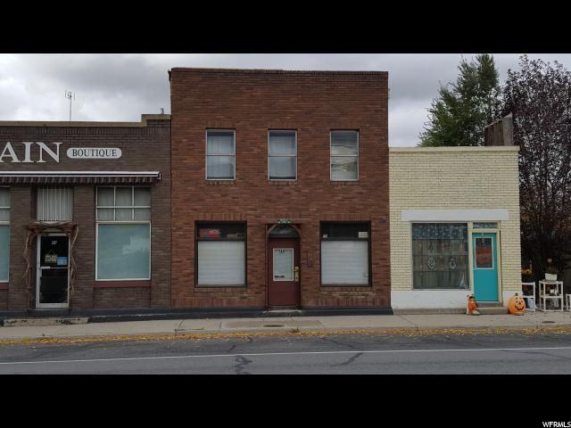 Great rental property. Two apartments with store front on Main street, Fairview.   Electrical and plumbing have been updated. Both water heaters are about 2 years old. Utilities are all on one meter.  Square footage figures are a courtesy estimate. Store front is approximately 400 square feet.
