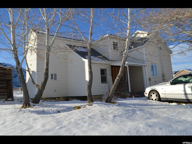 Don't miss this stunning piece of heavenly country! This beautiful home has been totally renovated including electrical and plumbing. The kitchen has been beautifully updated with newer cabinets throughout. Tile, newer bathrooms, and tons of windows so you'll be flooded with natural light! Mature trees dot the lot so you will have plenty of shade and a feeling of seclusion. Please notice the pictures of the open and lovely surrounding area - country living at its best!