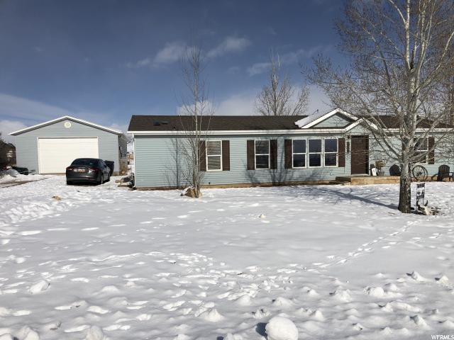 HERE'S YOUR OPPORTUNITY!!  RARE FIND! 1 ACRE Horse property w/Great Updated Manufactured Home w/Large Detached Garage/Shop 36x25!  4 Bedrooms! 2 Bathrooms! Nicely Located in a Beautiful Fountain Green on a Dead End road! Only 15 min east of Nephi!