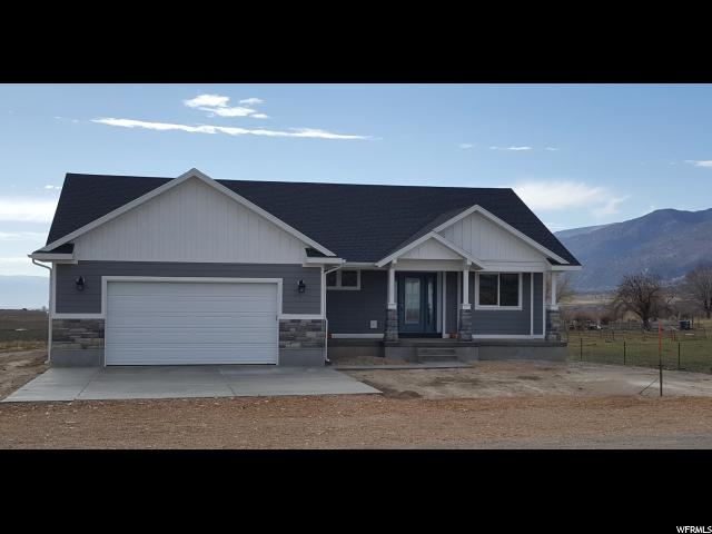 Brand New Custom Home. Available Now. Total Square Footage: 3450 (1650 main level, finished) (1650 full unfinished basement plus 150 cold storage) (550 garage) - Very quiet cul-de-sac on the edge of a friendly, small town. 15 minutes (13 miles) from I15 freeway. - Beautiful views of Horseshoe Mountain, Skyline Drive, and Mount Nebo. 5 miles from Maple Canyon. - Spacious entry to the vaulted Great Room with an open floor plan - Private back deck - Custom cabinets with Solid surface countertops - Waterproof LVP flooring - Covered front porch - Ceiling fans in all bedrooms - Insulated garage door with Wi-Fi Enabled opener - Full, unfinished basement with generous natural light - Extra-large cold storage room - Showing by appointment only - Buyer to verify all