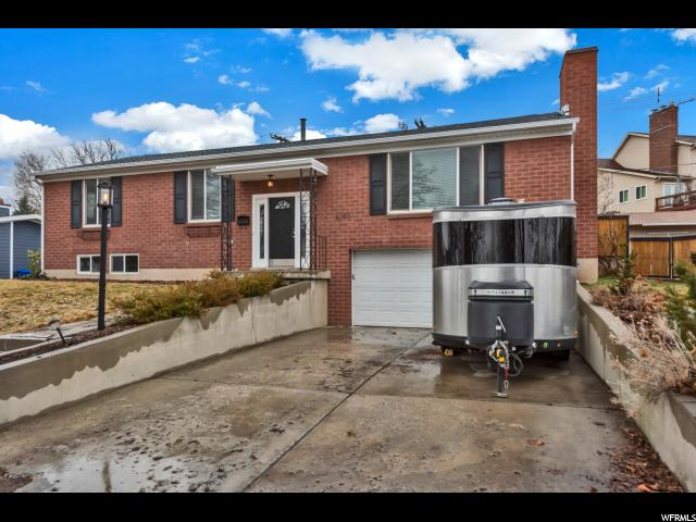 Home for sale at 4105 S 3340 East, Holladay, UT 84124. Listed at 490000 with 5 bedrooms, 3 bathrooms and 2,773 total square feet