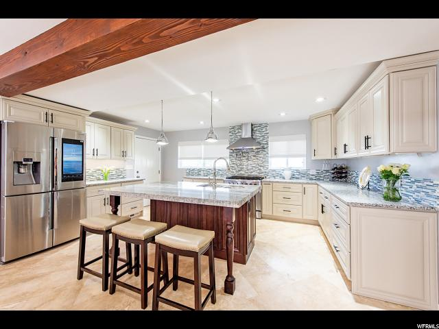 Home for sale at 2806 E Hermosa Way, Salt Lake City, UT 84124. Listed at 639900 with 5 bedrooms, 3 bathrooms and 2,648 total square feet