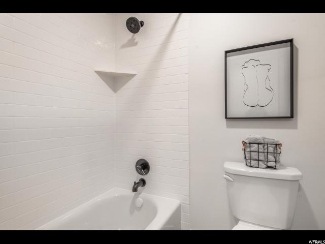 sedondary bath seperate toilet and tub