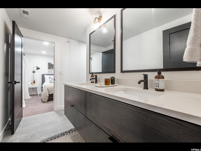 secondary jack and jill bath : double vanity - private shower and toilet room