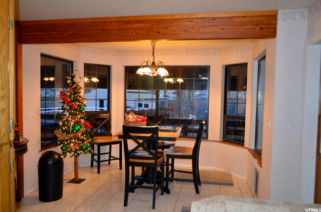 Dining Area Overlooks Backyard and Deck