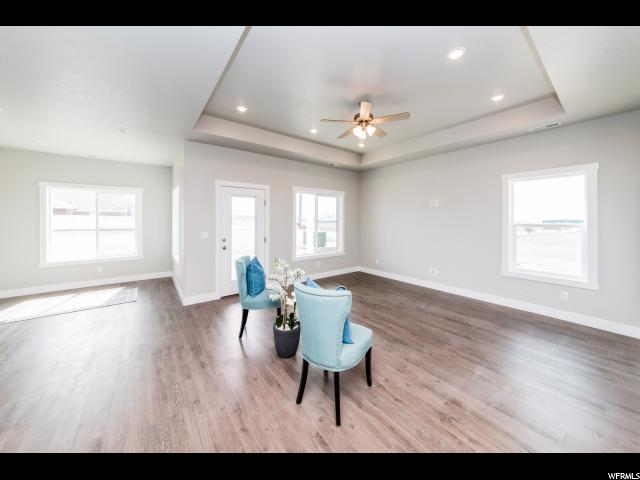 Great room perfect for group gatherings: Notice the lovely tray ceiling, (door goes to covered patio