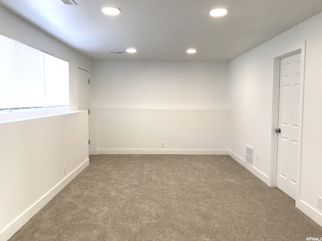 Basement family room with recessed lighting