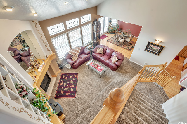 View from top of stairs looking into Family room and Dining Room off Kitchen