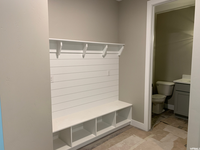 : Entry from Garage shelves 2 with 1/2 Bath