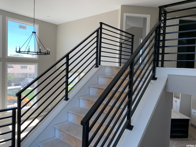 : 1st set of stairs leading into great room. There is a second set of stairs from the mud room to 2nd floor.