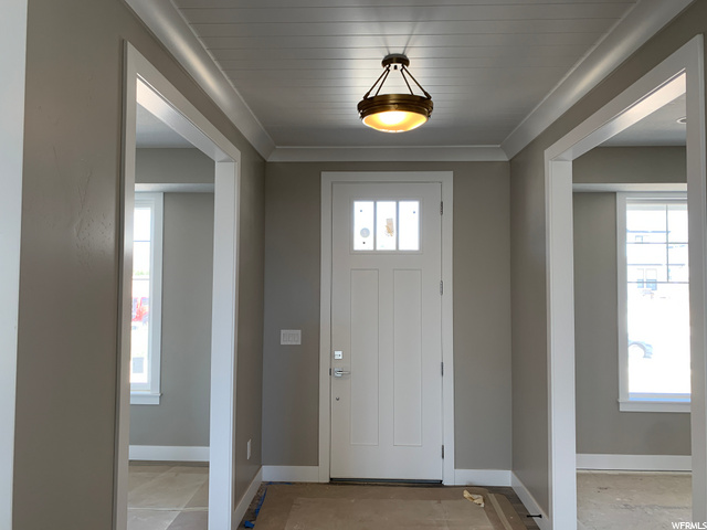 : Front Entry door - right and left are office and dining room
