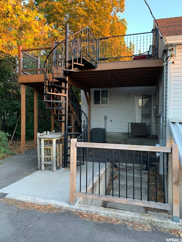 Spiral staircase goes up to attic apartment while stairs on the right going down to basement apartment