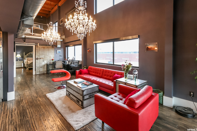 Sublime downtown penthouse loft done in 'Grandmillenial' style decor on both levels-from the retro crystal chandeliers to the comfort of a TV/gaming room, this unit has all the groovy vibe for a lock and leave lifestyle.  Tons of light and uninterupted views of downtown and eastern sunrises along the Wasatch-high ceilings and an open floor plan. Huge white marble waterfall island in the kitchen, Asko dishwasher, Wolf gas range and SubZero refrig all stay. Marble subway tiles surround the kitchen counter area and instead of cold concrete floors you get the beauty of wood surfaces. There's a new soft water and continuous hot water heater, but know the best of all is that this building draws from geothermal heat to help save the environmment and owner money. Could there be TWO PARKING spaces? There's parking across the street at the Crane building, and Vosen's bakery is closed at night...but no extra spaces via this HOA.  Good storage space on the 4th floor. Seller would negotiate furnishings if buyer is interested. Read agent remarks for showing information.