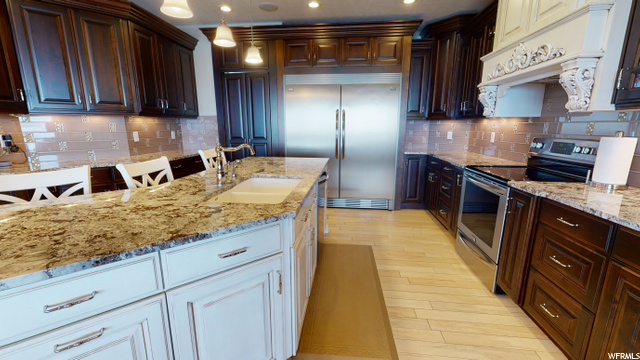 On the left side of the fridge is a hidden door leading to the Butlers pantry.