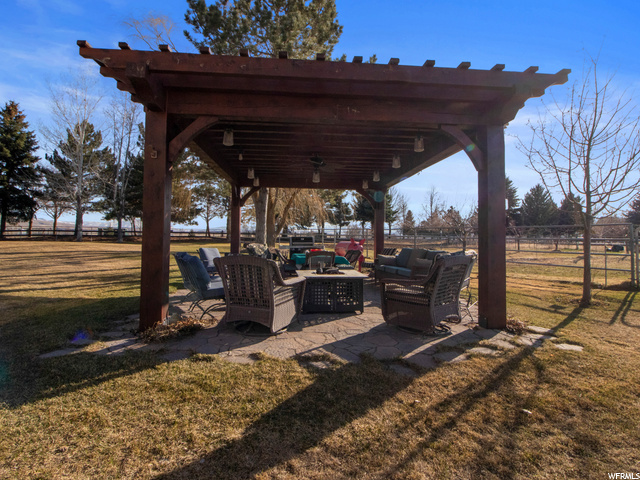 Outdoor pergola with firepit included
