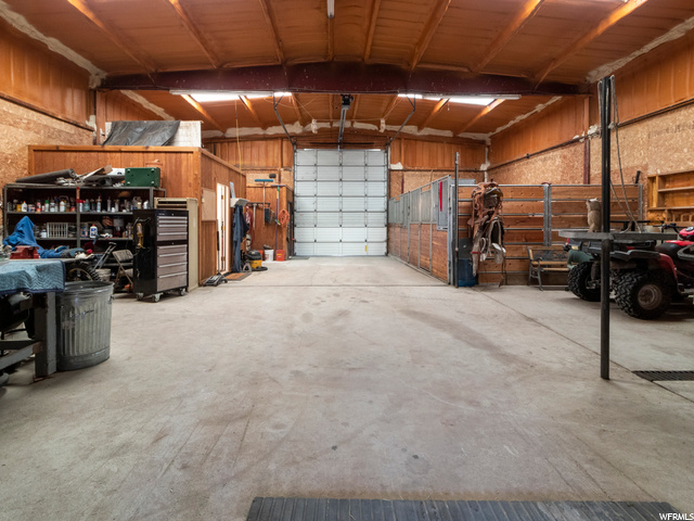 Gas heated shop area with RV storage and automatic garage door