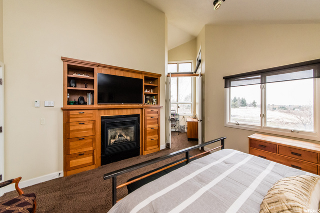 Master bedroom custom built ins and fireplace