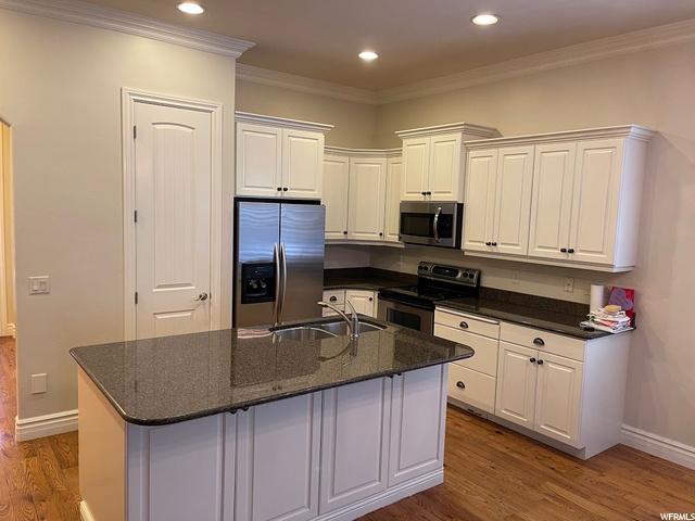 Updated kitchen with granite countertops.