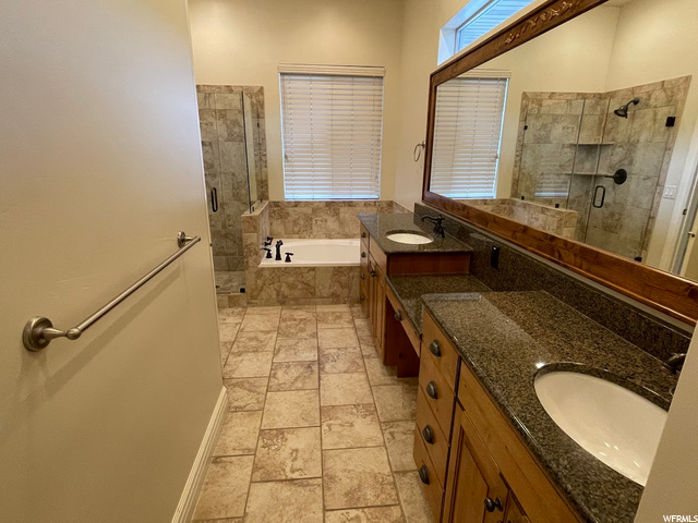 with double sinks, granite counters, and makeup station