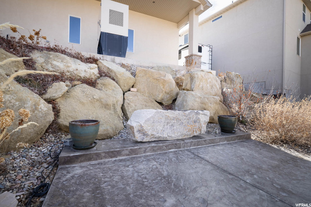 For outdoor furniture by waterfall and beautiful rock gas fireplace