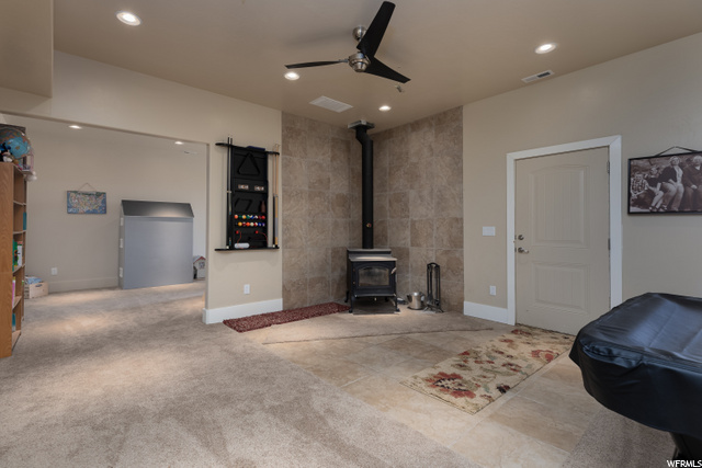 Wood stove in the basement with new carpet