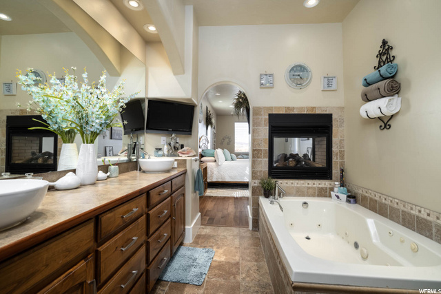 2 person jetted tub with gas fireplace