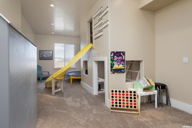 Large playroom with slide and built in playhouse