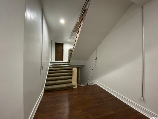 The door upstairs leads to balcony of in home gym, downstairs go to gym on main level.  The Gym is also below the living room.