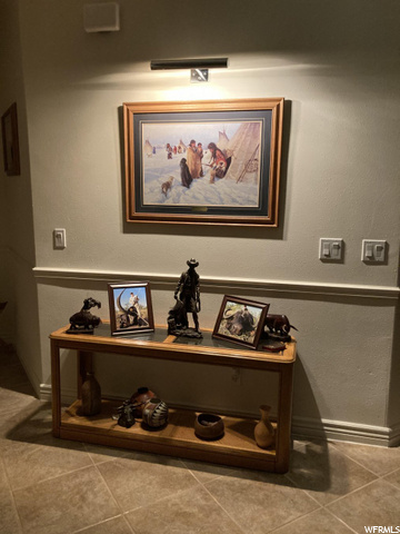 STRATEGICALLY PLACED ART HAS ITS OWN LIGHTING TO DISPLAY