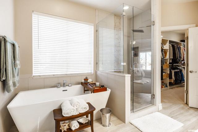 Honed Quartz Countertops, Free Standing Tub, Custom Tile work in Shower