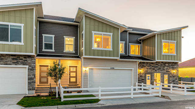 Contemporary exterior with front-load garage.