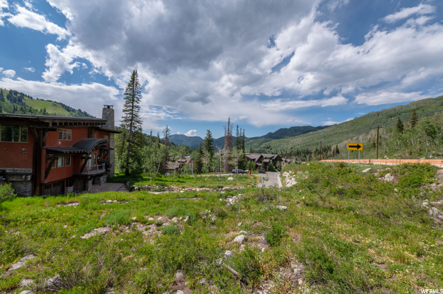 your home would be in the distance just to the right of that existing ski chalet.